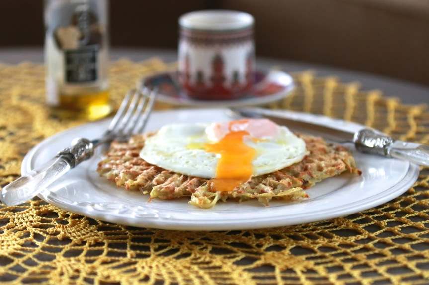 Potato pancakes with runny eggs and truffle oil