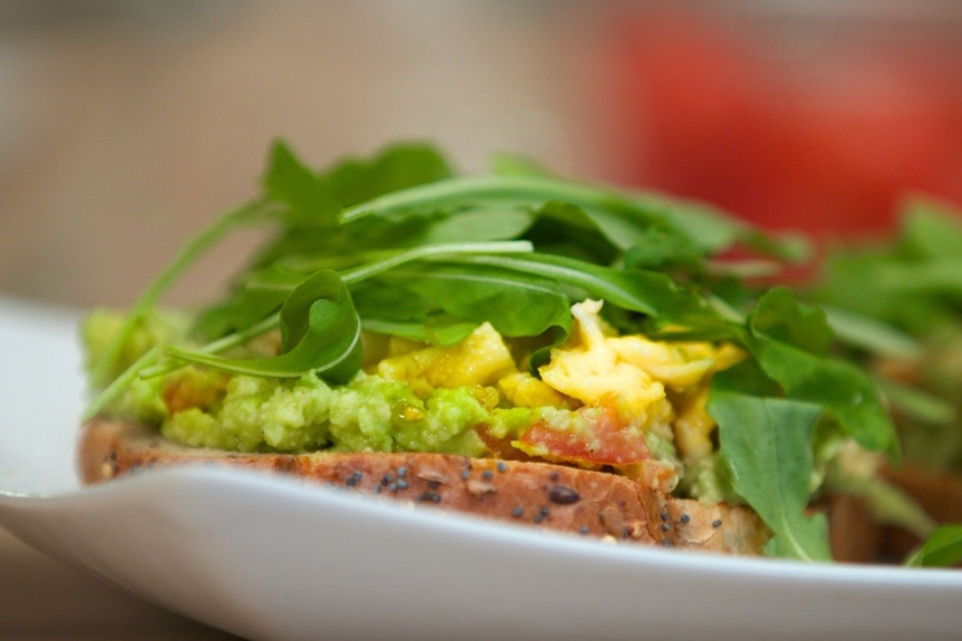 Toast with avocado and scrambled eggs