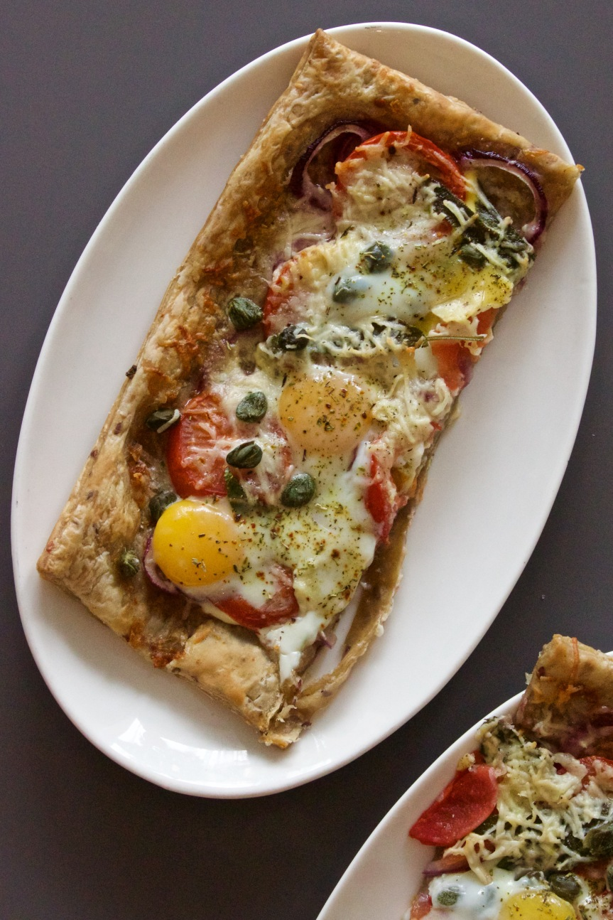 Breakfast pizza with runny quail eggs