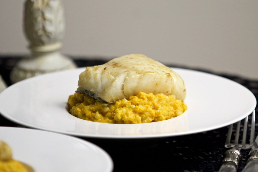 Butter poached cod and cream of carrots with pearl couscous